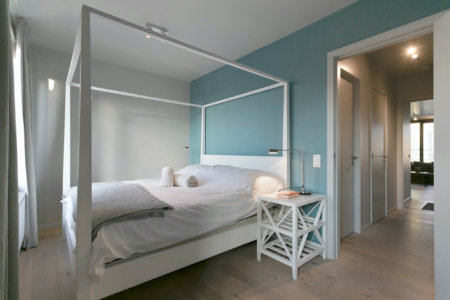 spacious double bed in romantic bedroom near european commission