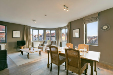 dining and living space in serviced one bedroom apartment near european commission
