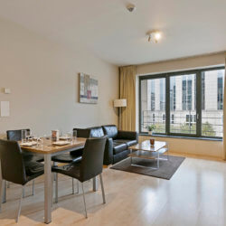 spacious living room and dining table in studio apartment brussels city