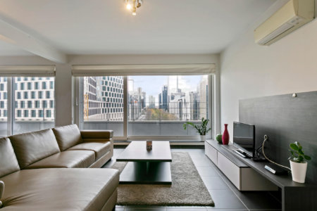 manhattan view two bedroom apartment living space with view down esplanade