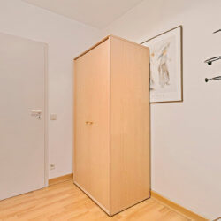 entrance to studio apartment with storage cupboard