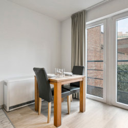 dining table for two in serviced studio apartment near european commission