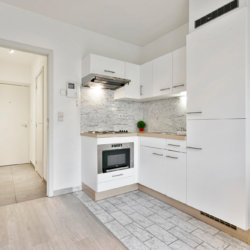 fully equipped kitchen with microwave oven near european commission
