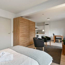 bbf serviced apartment with double bed and wardrobe near european commission