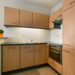 fully equipped kitchen with dishwasher in two bedroom serviced apartment
