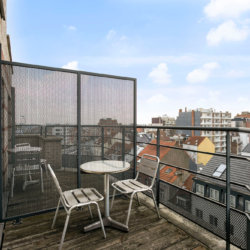 outdoor balcony with table and chairs in serviced apartment