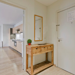 entrance hallway into three bedroom furnished apartment near european commission
