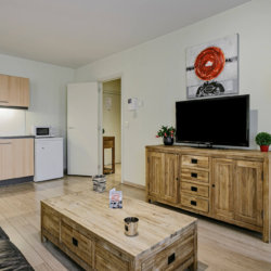 flat screen cable television and coffee table in living rooom