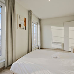 double bed and artwork in serviced bbf apartment