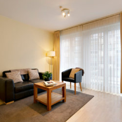 living room with sofa and cable television near place jourdan in etterbeek