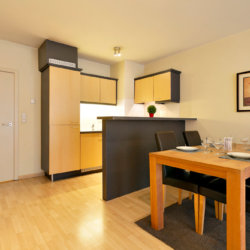 fully equipped kitchen with dining tablein bbf serviced apartment in etterbeek near place jourdan