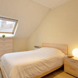 double bed in master bedroom in etterbeek brussels