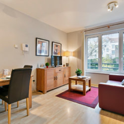 spacious living room with cable television in serviced apartment in etterbeek