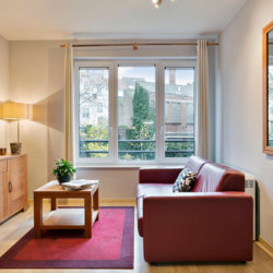 living room with sofa and cable television in bbf serviced apartment in etterbeek