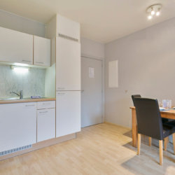 fully equipped kitchen with utensils and dining table near famous place jourdan in etterbeek brussels