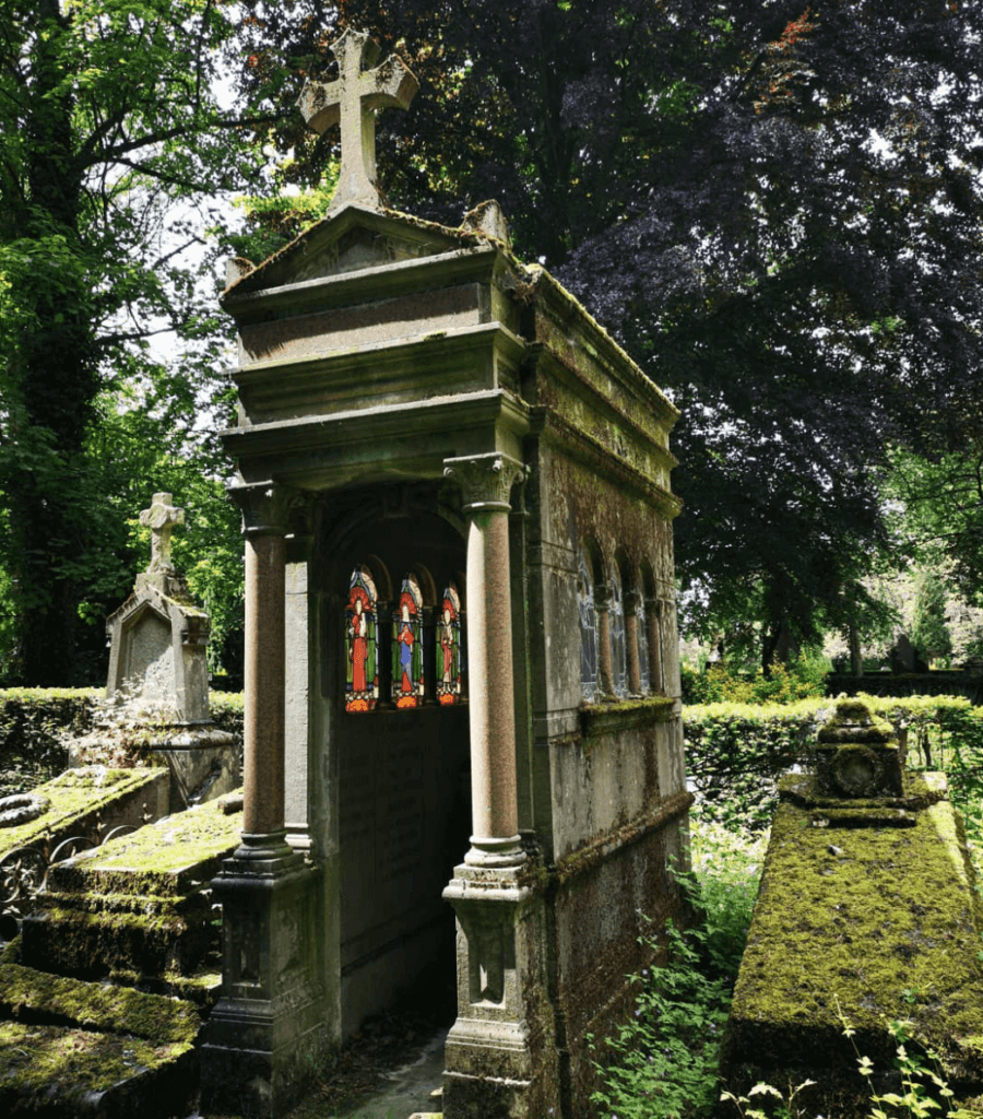 beautiful old graves in the brussels cemetery with stain glass windows