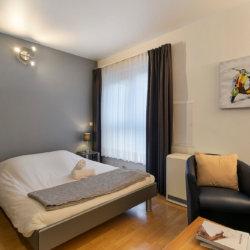 spacious double bed in studio apartment in the european quarter