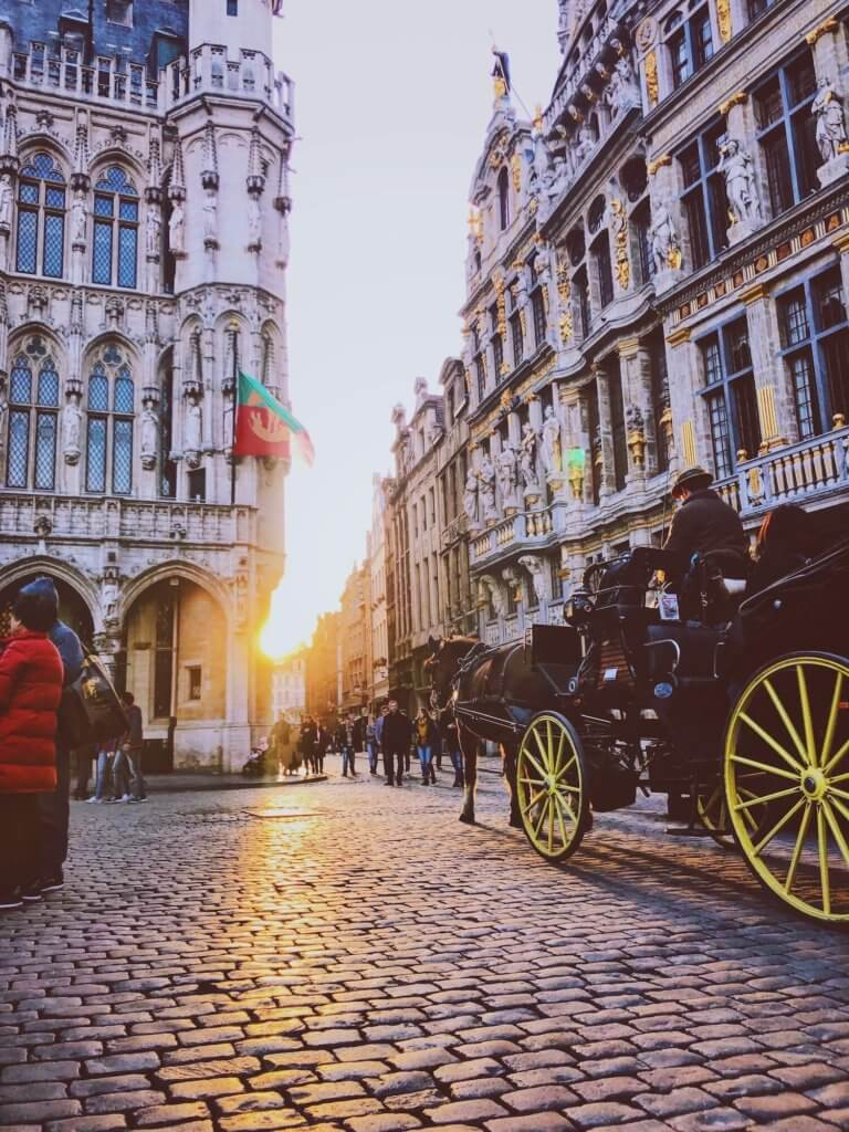 horse and cart in the centre of grand place in brussels