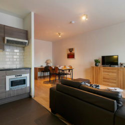 fully equipped kitchen in furnished apartment with cable television walking distance to european commission