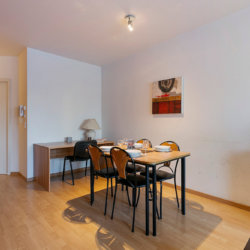living space and office desk next to european commission in two bedroom furnished apartment