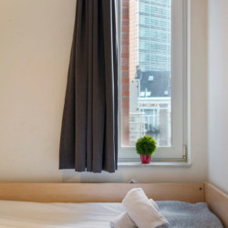 single bed in second bedroom with views onto the european commission