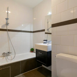 bathroom with bathtub in two bedroom apartment with towels and cleaning included