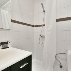serviced studio bathroom with shower with cleaning and towels