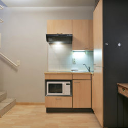 fully equipped kitchen in bbf furnished apartment opposite park cinquantenaire