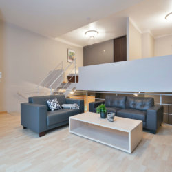 spacious living room with two large sofas in two bedroom serviced apartment