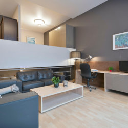 spacious living room with two large sofas in two bedroom furnished apartment