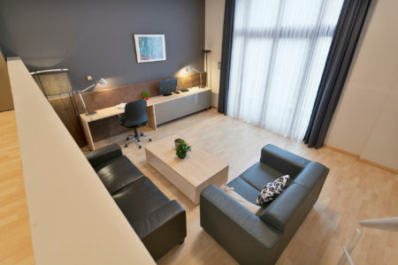 view over living room and office space in two bedroom furnished apartment near european commission