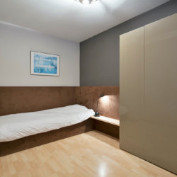 second bedroom with single bed in bbf serviced apartment