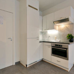 fully equipped kitchen in studio apartment opposite cinquantenaire