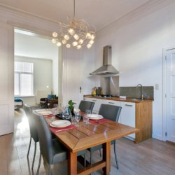 dining room with fully equipped kitchen in brussels