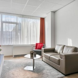 sofa and chair in furnished apartment brussels city centure