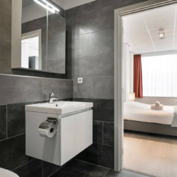 renovated bathroom with shower in central brussels bbf serviced apartment