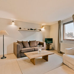spacious living room in large serviced studio apartment in etterbeek