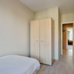 second bedroom with single bed and wardrobe
