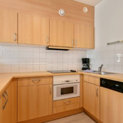 fully equipped kitchen with dishwasher in louise two bedroom apartment