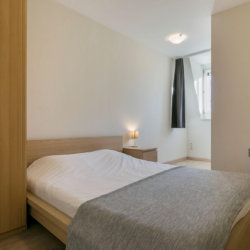 double bed with linens in serviced bbf apartment