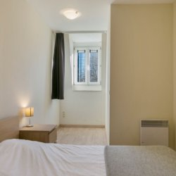 double bed with linens in serviced bbf apartment with window