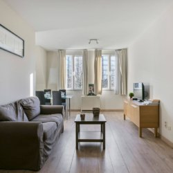 sofa with cable television in bbf serviced apartment brussels