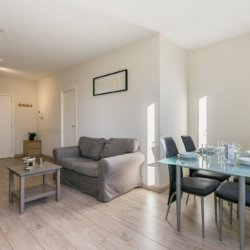dining table and living room in furnished apartment brussels