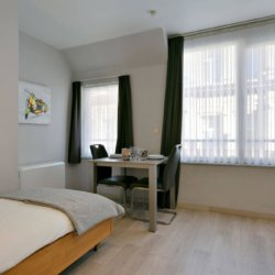 single bed and two person dining table in bbf serviced apartment