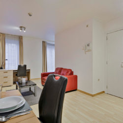 dining table and living space in serviced apartment near european commission