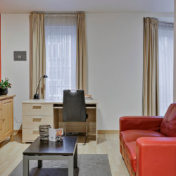 living room with office work desk and cable television in european quarter