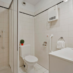 bathroom with shower and toilet and bi-weekly cleaning