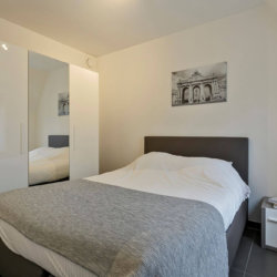 master bedroom in bbf serviced apartment with storage wardrobes west brussels