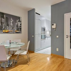 spacious ldining space and fully equipped kitchen in bbf serviced apartment brussels