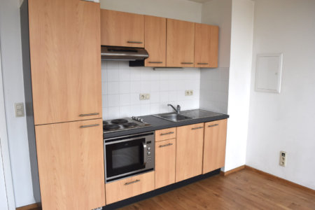 unfurnished studio apartment in south brussels kitchen with microwave